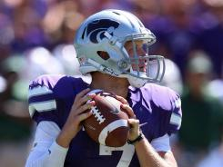 Kansas State quarterback Collin Klein threw for one touchdown and ran for three more in Kansas State's rout of Miami.