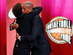 Reggie Miller, right, hugs his sister, fellow Basketball Hall of Famer Cheryl Miller, at his induction ceremony in Springfield, Mass., on Friday.