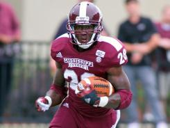 Mississippi State running back LaDarius Perkins carries against Auburn in Saturday's 28-10 win vs. the Tigers.