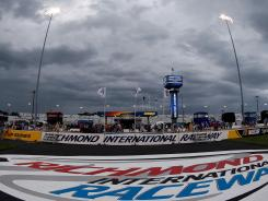 Dark clouds followed by intense rain hit Richmond International Raceway Saturday evening, delaying the start of the Sprint Cup race.
