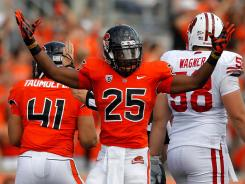 Oregon State's Ryan Murphy celebrates a stop on fourth down against Wisconsin on Saturday.