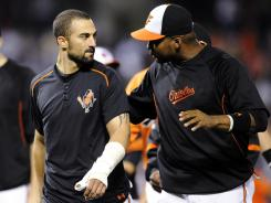 Orioles outfielder Nick Markakis, left, wears a soft cast on his left thumb after breaking it Saturday on a pitch from Yankees starter CC Sabathia.