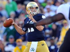 Notre Dame Fighting quarterback Tommy Rees (11) throws in the fourth quarter against Purdue.