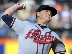 Atlanta Braves starter Kris Medlen pitches in the first inning of Saturday's 11-3 win at the New York Mets.
