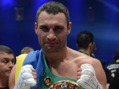 Vitali Klitschko shows off his WBC heavyweight belt after his win against Manuel Charr to defend it.
