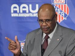 In this Dec. 14, 2011 file photo, Amateur Athletic Union president Louis Stout make comments during a news conference at AAU headquarters in Lake Buena Vista, Fla.