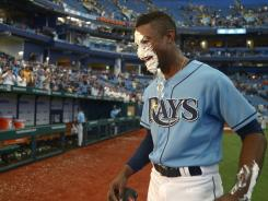 B.J. Upton hit three solo home runs in the Rays' 6-0 win over the Rangers on Sunday.