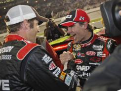 Jeff Gordon celebrates with crew chief Alan Gustafson after qualifying for the Chase for the Sprint Cup with a second-place finish at Richmond.