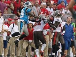 Buccaneers defensive back Ahmad Black (43) intercepts the ball in the second half against the Carolina Panthers at Raymond James Stadium.