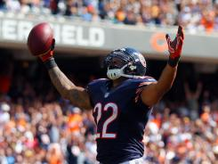 Chicago Bears running back Matt Forte celebrates his touchdown run during the second half against the Indianapolis Colts at Soldier Field. The Bears won 41-21.