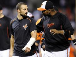 The Orioles' Nick Markakis leaves the field with his broken thumb wrapped after a 5-4 win against the Yankees on Saturday. He is out for the rest of the regular season and possibly the playoffs if Baltimore makes it.