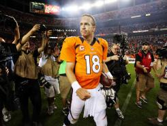 Broncos quarterback Peyton Manning (18) walks off the field after beating the Steelers in Sunday night's season opener.