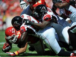 The Falcons defensive lines piles on Chiefs running back Peyton Hillis. Atlanta won the game 40-24.