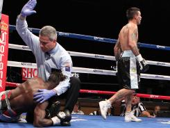 Lucas Matthysse of Argentina walks away after knocking down Nigerian Olusegun Ajose in the 10th round to win the interim WBC light welterweight title Satgurday in Las Vegas.