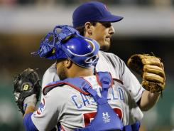 Cubs starter Jeff Samardzija and catcher Welington Castillo embrace after a 4-3 win Saturday vs. the Pirates. Samardzija threw a complete game and Castillo homered.