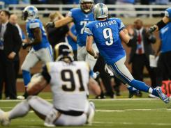 Rams defensive end Chris Long watches Lions quarterback Matthew Stafford celebrate a touchdown in the fourth quarter.