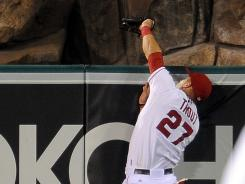 Angels center fielder Mike Trout robs a home run from Tigers first baseman Prince Fielder for the final out of Saturday's 6-1 Los Angeles win.
