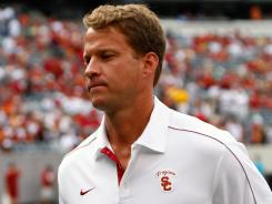 Southern California coach Lane Kiffin says he doesn't care if his team drops in the coaches poll as long as the Trojans continue to win.