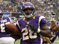 Vikings RB Adrian Peterson scored twice Sunday in his return from 2011 knee surgery.