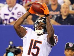 Bears quarterback Jay Cutler has a big target in receiver Brandon Marshall, above.