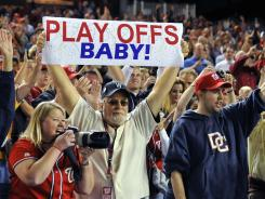 Fan holds a sign in support of the team after the Nationals clinched a wild card spot.