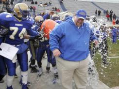 Phoebus head coach Stan Sexton, right, who has won three consecutive Virginia Division 5 state titles, was replaced by an assistant.
