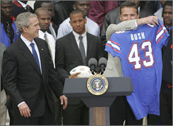 Florida coach Urban Meyer, right, displays a Florida jersey for President Bush.