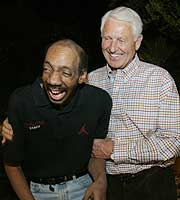 Arizona coach Lute Olson shares a laugh with Kenny Arnold during a reunion Olson held for his 1980 Iowa Hawkeyes team at his home in Tuscon.