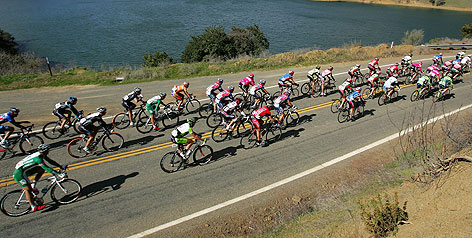 Cyclists race past Lake Berryessa near Winters, Calif., during Tuesday's stage of the Tour of California.