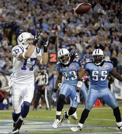 Indianapolis Colts wide receiver Austin Collie catches a 6-yard-touchdown pass ahead of Tennessee Titans defenders Michael Griffin (33) and Stephen Tulloch in the third quarter of the Colts' 31-9 win.