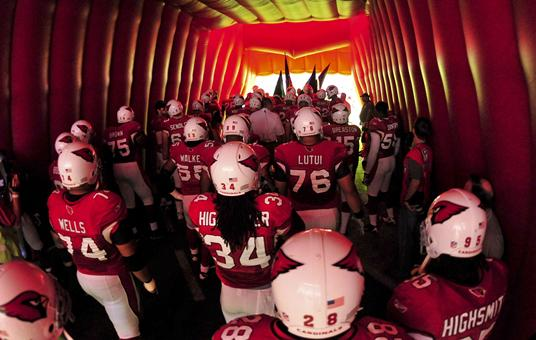 university of phoenix logo pictures. in a tunnel before taking the field at University of Phoenix Stadium.