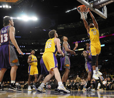 The Lakers' Andrew Bynum dunks home two points in front of teammate Pau
