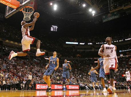 lebron james heat dunking. Miami Heat forward Lebron