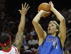 Dirk Nowitzki once again led the Mavericks' comeback with 23 points and 12 rebounds as Dallas' overtime victory moved them into second place in the Western Conference.
