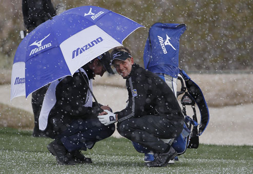 luke donald wife diane. Luke Donald of England, right, ducks under an umbrella with his caddy as snow falls during