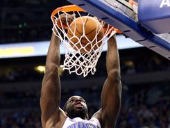 Magic power forward Brandon Bass dunks against the Hawks during the Magic's 88-82 win. The Magic tied the series 1-1.