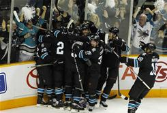 The Sharks celebrate after center Joe Pavelski scored the game-winning goal in overtime against the Los Angeles Kings in San Jose.