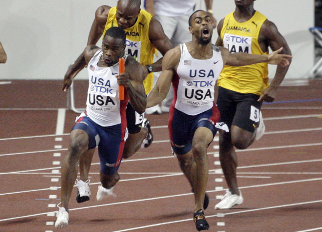 s070901 gay The United States' Tyson Gay hands the baton to Leroy Dixon during the men's ...