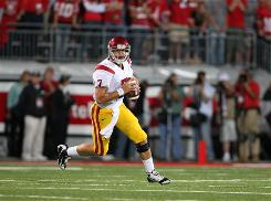 USC quarterback Matt Barkley scrambles against Ohio State on September 12 at Ohio Stadium. The Trojans beat the Buckeyes 18-15, and USC coach Pete Carroll is hopeful that both Barkley and safety Taylor Mays will be able to play Saturday night against Washington State.