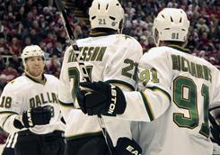 The Stars' Brad Richards, right, is congratulated on his goal by teammate James Neal and Loui Eriksson during the fthe Stars' 4-3 win on Sunday in Detroit.