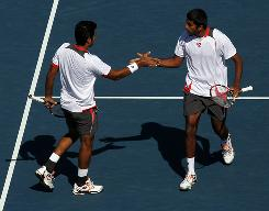 Rohan Bopanna of India and Aisam-Ul-Haq Qureshi of Pakistan are on their way to the U.S. Open doubles final after defeating Eduardo Schwank and Horacio Zeballos of Argentina on Wednesday in New York.