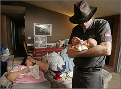 Walter Scott Edwards II, right, holds his newborn son Walter Scott Edwards III.