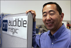 Audible Magic founder Vance Ikezoye in his office in Los Gatos, Calif. Ikezoye may end up controlling what millions of Web surfers can and can't watch as more online video sites adopt Audible Magic's filtering technology.