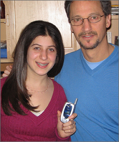 Surprise! Before Lauren Fodeman, with dad Doug Fodeman, used her new cellphone, it beeped with a text message that led to a $9.99 charge.