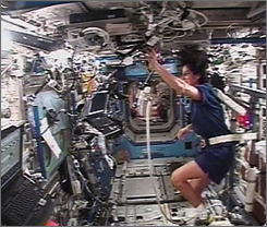 Flight engineer Sunita Williams can be seen using an exercise device in the lab of the International Space Station, Feb. 22, 2007.
