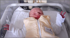 Newborn baby Raphael, born in Cologne, Germany, around half past midnight on Jan. 1. A newborn has cortex neurons, heart muscle cells and eye lens cells he will still have the day he dies.