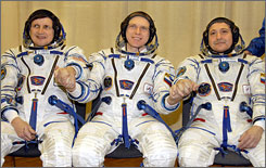 Former Microsoft software developer Charles Simonyi left, Russian cosmonauts Oleg Kotov and Fyodor Yurchikhin train in Kazakhstan on March 28. Simonyi will blast off to the International Space Station on Saturday as a menber of this international crew.