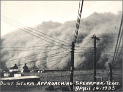 A dust storm approaches Spearman, Texas, in this 1935 file photo. Research models suggest that climate in the southwestern USA began a transition to drier conditions late in the 20th century and is continuing the trend in this century.