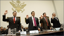 Mark Chandler of Cisco, left, Elliot Schrage of Google, Jack Krumholtz of Microsoft and Michael Callahan of Yahoo during a 2006 Capitol Hill hearing on China and the Net.