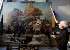 Stephen Kornhauser, chief conservator of paintings, points to the Emanuel Leutze painting, The Storming of the Teocalli by Cortez and His Troops. It is under study for restoration at the Wadsworth Atheneum in Hartford, Conn.